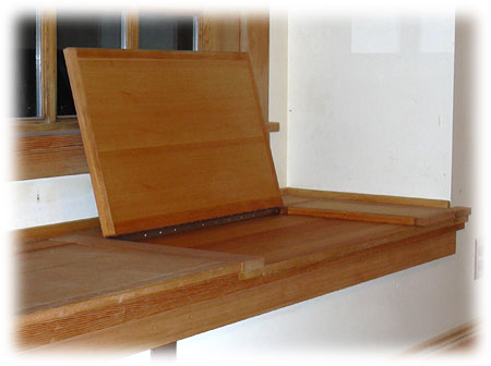 Recessed wall bench with built-in storage with an open lid
