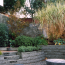 A sunken outdoor area with a curving masonry wall.