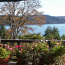 A deck with flower planters, deck furniture, and a sweeping view of puget sound.